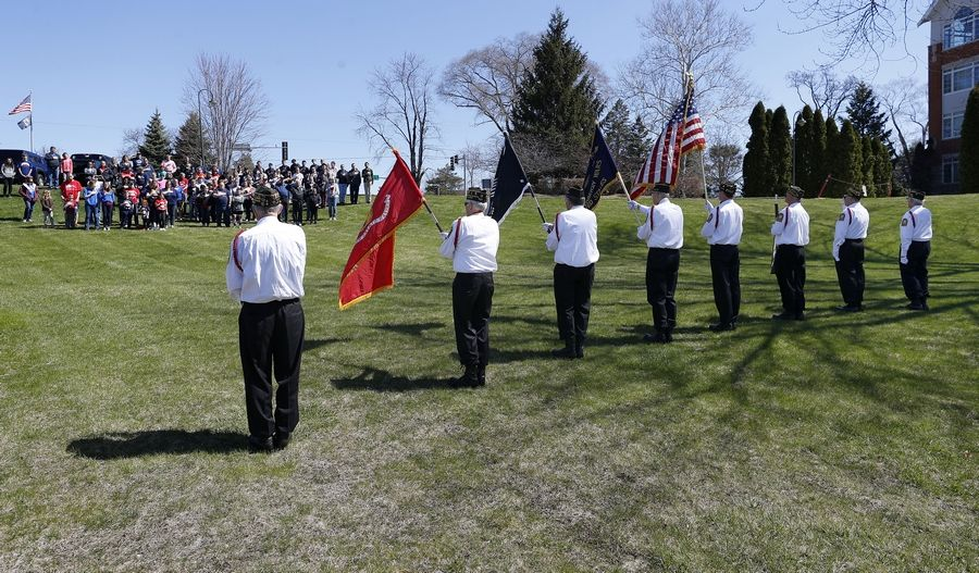 The Arlington Heights VFW Post 981 color guard presented the colors during the national anthem Sunday as Help USA Troops held a shipping party at AMVETS Post 66 in Wheeling.