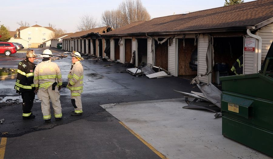 A fire ravaged about a dozen detached garages Monday evening at a Round Lake Beach apartment complex.