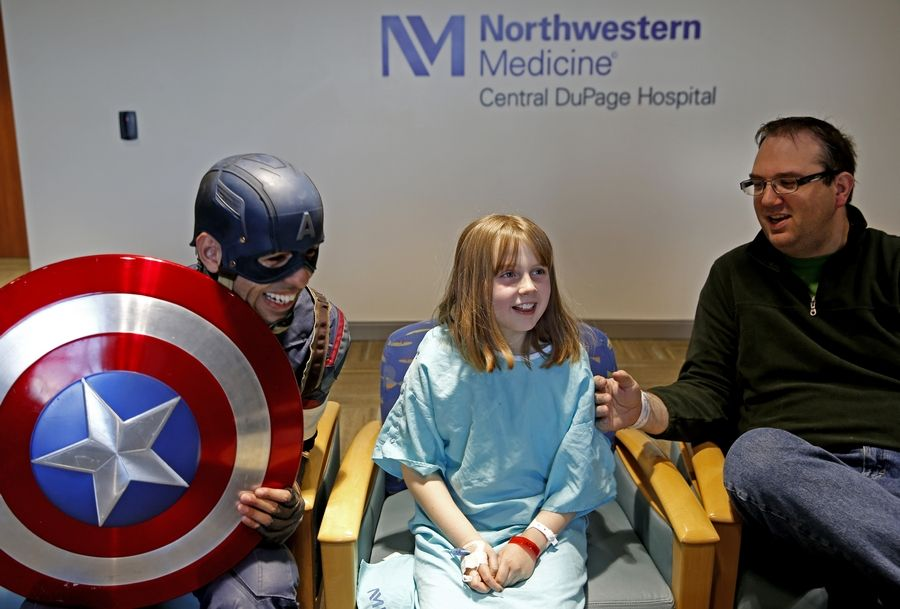 Captain America visits Wheaton resident Teagan Kunkel and her dad, Jeremy, at Northwestern Medicine Central DuPage Hospital.