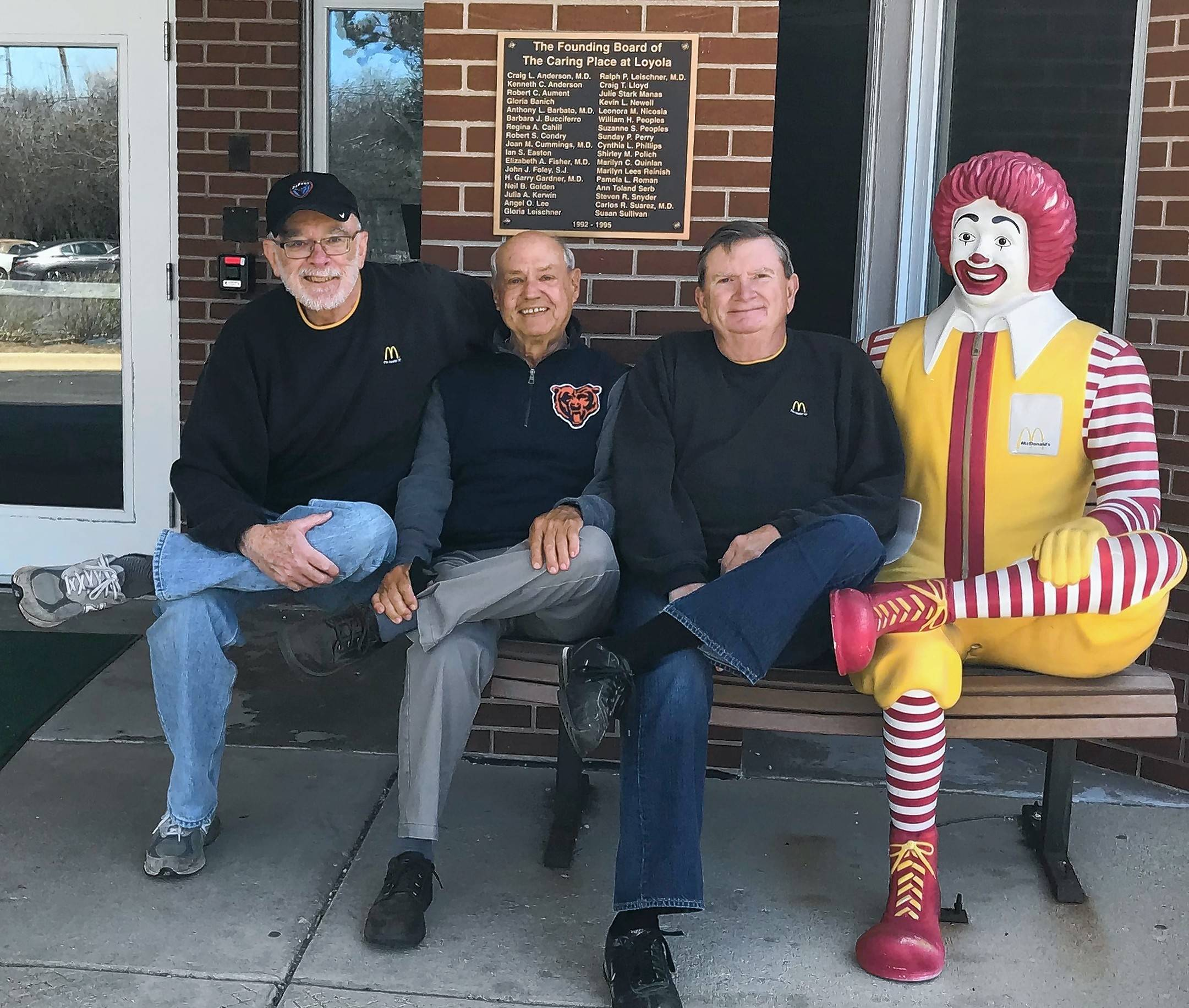 Volunteers Bill Drennan and Jim Korreck of Schaumburg and Mike Dewbray of Darien pose with Ronald McDonald. They volunteer together at the Ronald McDonald House near Loyola University Medical Center.