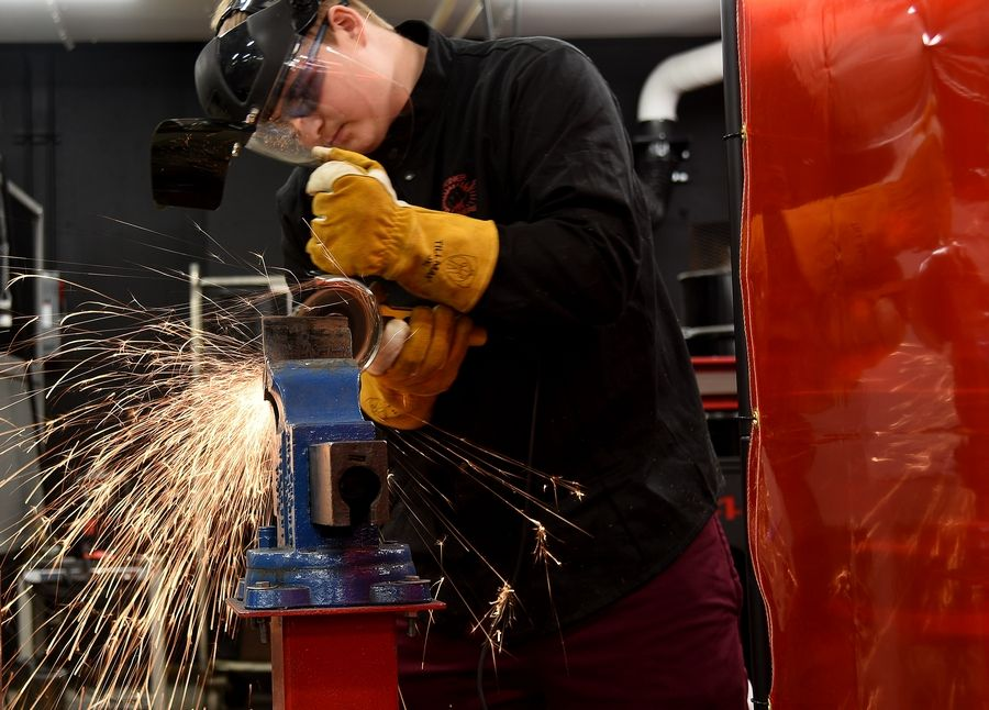 Elgin High School sophomore Michael Stine grinds a piece of metal at the school's welding lab, which has been certified by the American Welding Society as an accredited testing facility.