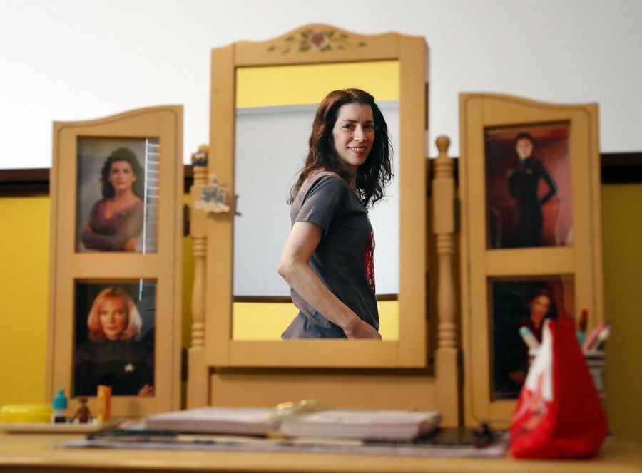 "Maria Jose Tenuto is reflected in a mirror featuring famous female characters from ""Star Trek."""