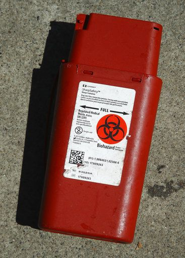 In this photo taken on Thursday, April 26, 2018, a biohazard container used for the storage of used needles sits on a sidewalk in San Francisco. San Francisco may have hit peak saturation with tent camps, stinky urine and trash littering its filthy streets. And a new interim mayor has vowed to do something about it. In the last few weeks, Mayor Mark Farrell has promised $700,000 to hire more people just to pick up discarded needles and $13 million over the next two years for more heavy duty steam cleaners and pit stop toilets.
