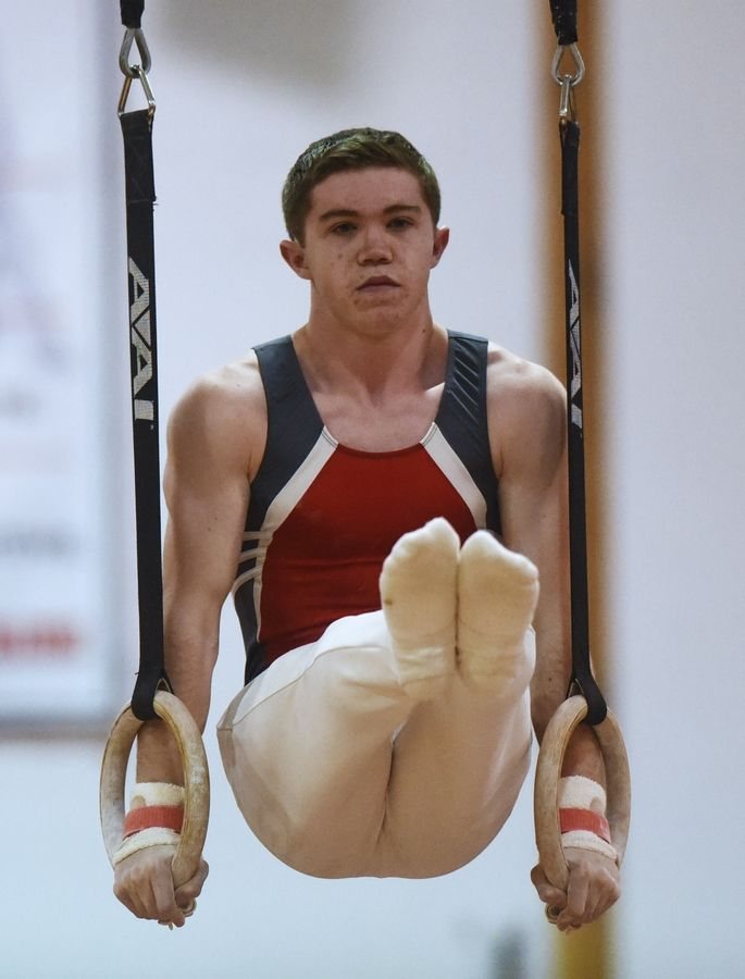 Mundelein's Tyler Collins competes on the still rings during Tuesday's boys gymnastics sectional at Mundelein.