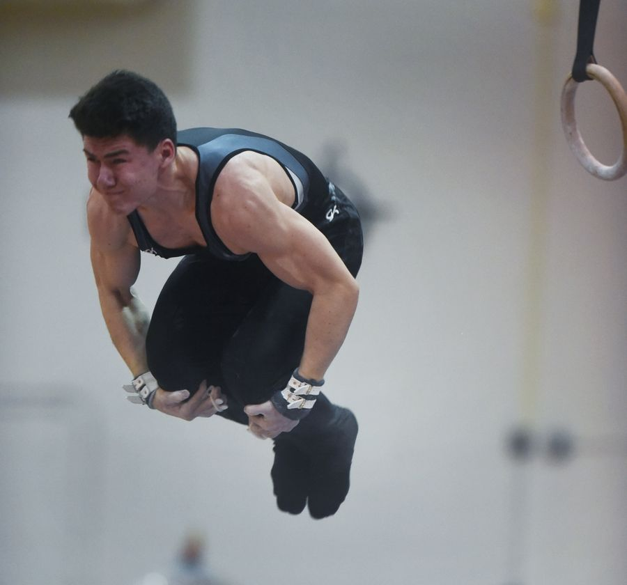 Willowbrook's Daniel Lopez Egan dismounts from the still rings during Tuesday's boys gymnastics sectional at Mundelein.