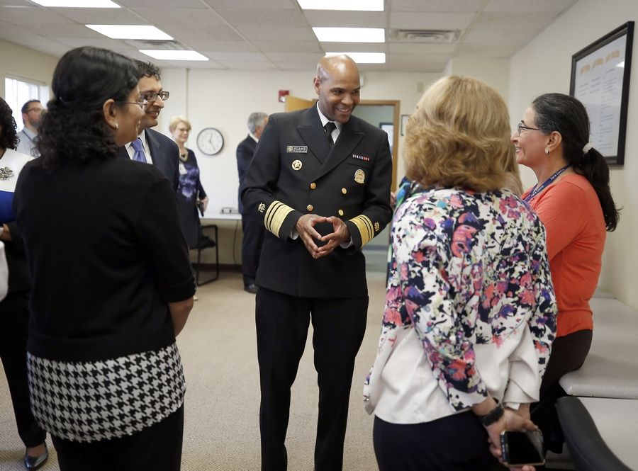 Dr. Jerome Adams, U.S. Surgeon General speaks with staff members Wednesday while touring the Kane County Health Department in Aurora during a visit to discuss his efforts to address the opioid epidemic.
