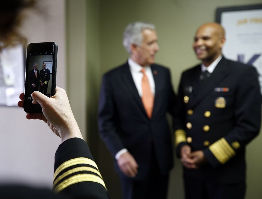 Kane County officials including board Chairman Chris Lauzen met Wednesday with U.S. Surgeon General Dr. Jerome Adams, who visited the Western suburbs at the invitation of 14th District U.S. Rep. Randy Hultgren.