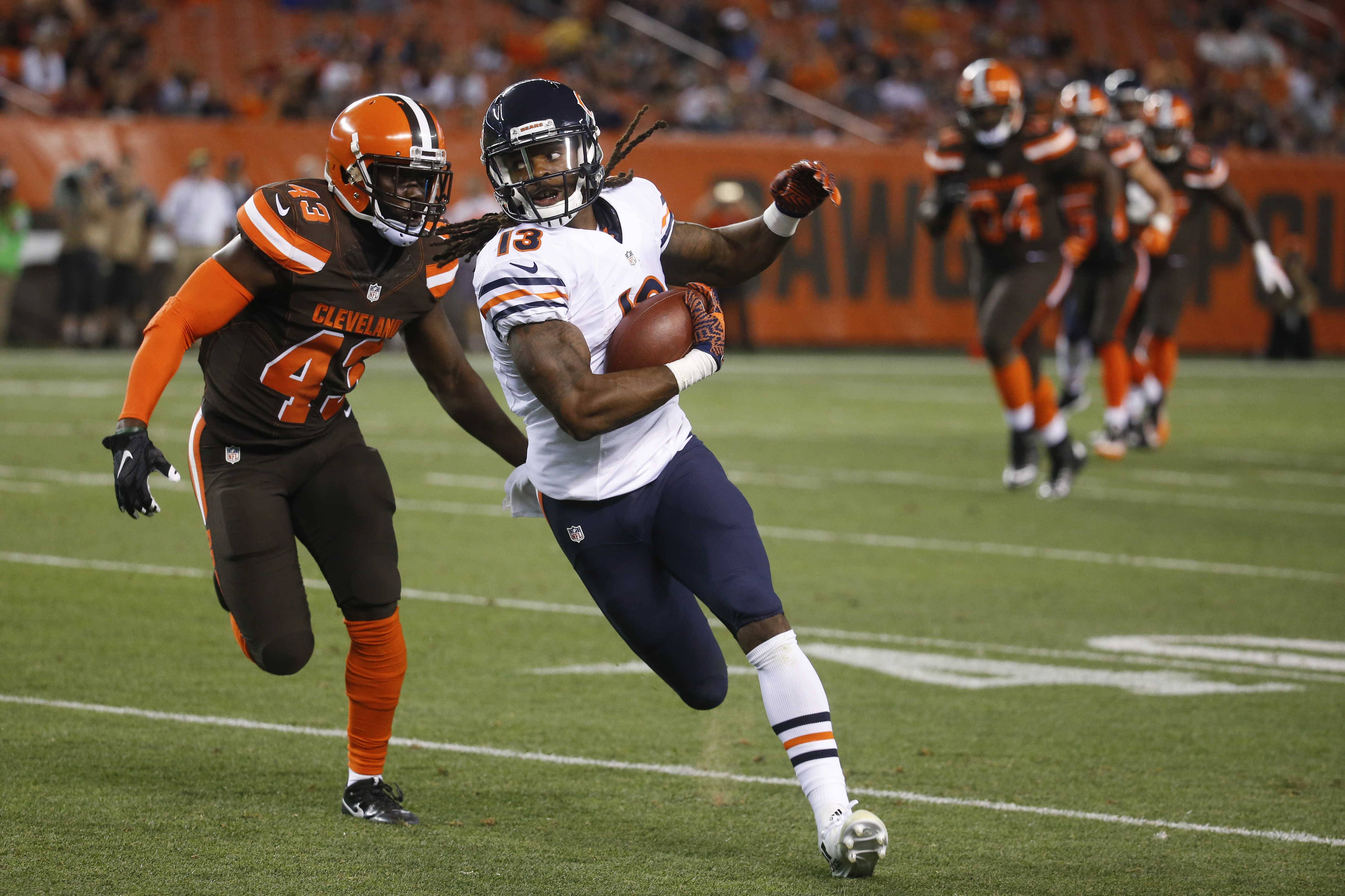 Chicago Bears wide receiver Kevin White (13) runs the ball with Cleveland Browns cornerback Charles Gaines (43) in pursuit in the first half of an NFL preseason football game, Thursday, Sept. 1, 2016, in Cleveland.