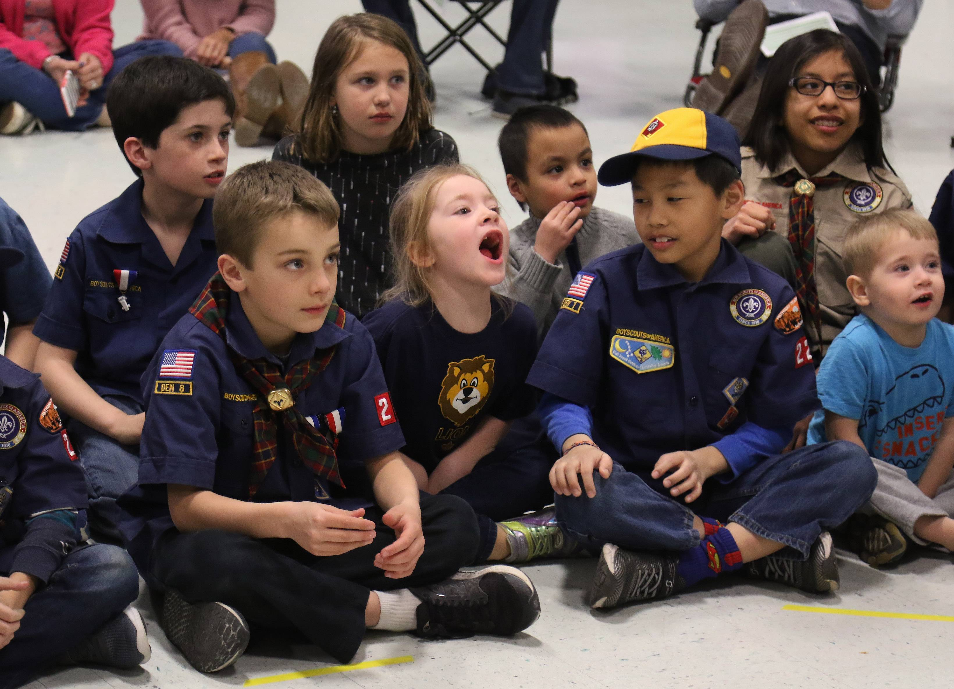 Addison Carver, 6, of Lake Barrington, center, roars like a lion during a March meeting of Cub Scouts at North Barrington Elementary School. Cub Scout Pack 229 is coed.