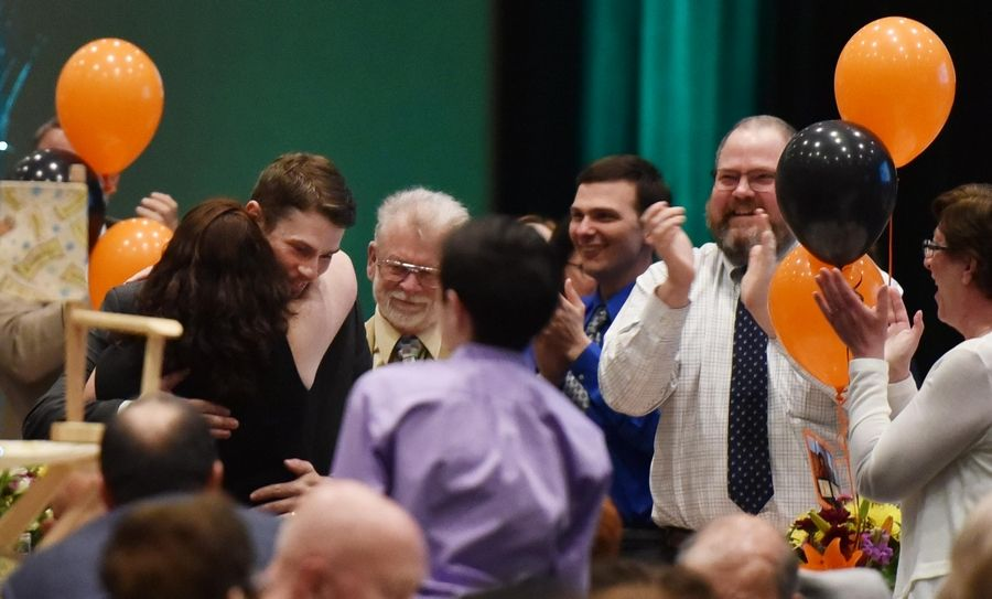 Kyle Matthew Libberton, of St. Charles East High School, with supporters after he won the Kane County Educator of the Year Friday at a banquet at the Q Center in St. Charles.