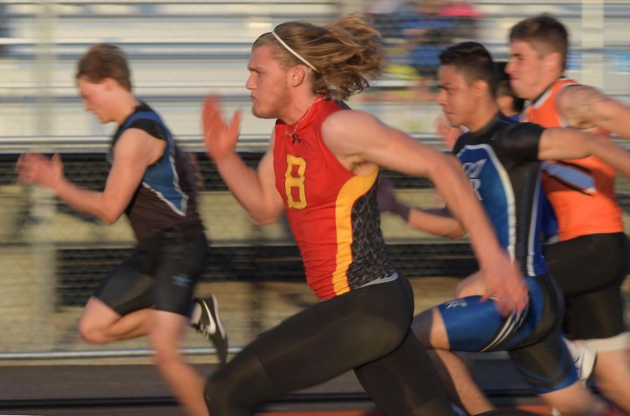 Batavia's Thomas Stuttle flies down the track in the 100 meter dash at the Kane County boys track meet at East Aurora High School Friday.