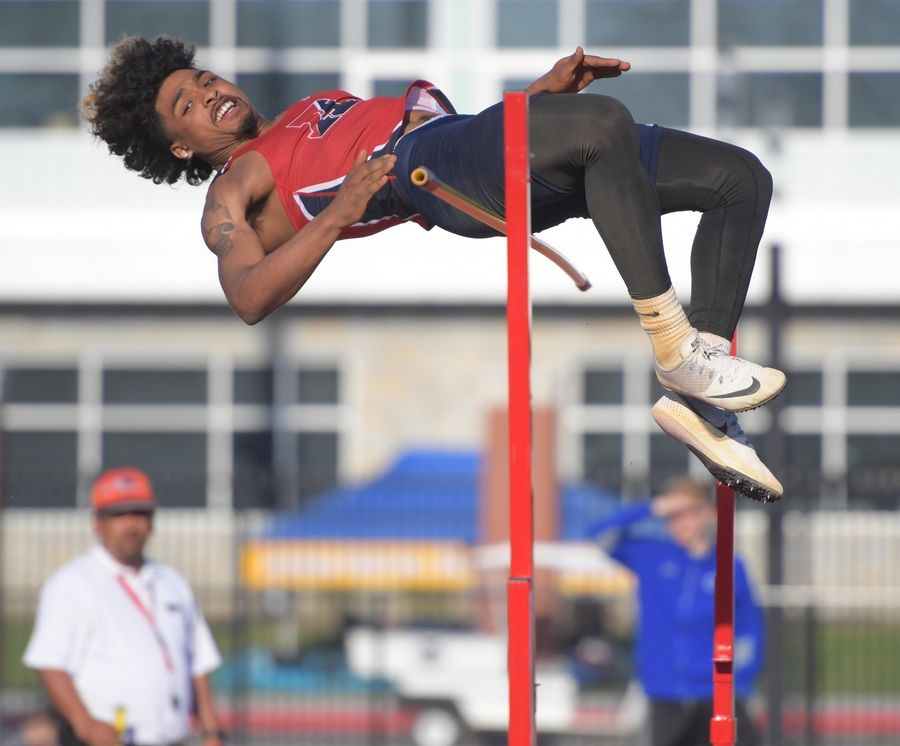 West Aurora's Camron Donatlan misses at 7 feet one inch but won the high jump by clearing 6 feet four inches at the Kane County boys track meet at East Aurora High School Friday.