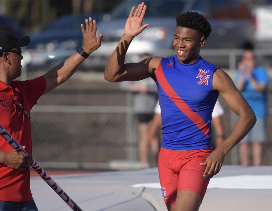 West Aurora's Andre Jones celebrates his pole vault win at the Kane County boys track meet at East Aurora High School Friday.