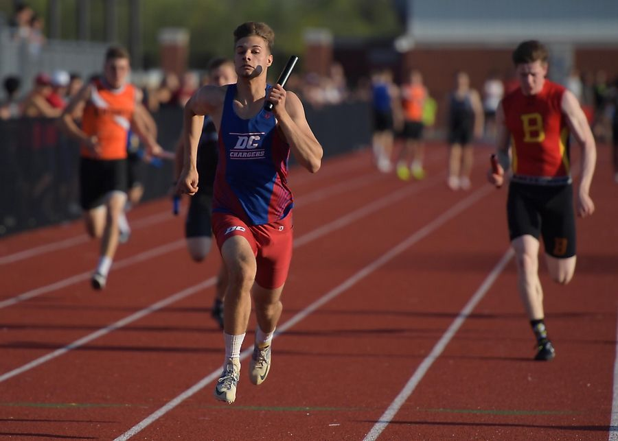 Dundee Crown's Dylan Becker leads the pack as the anchor leg of the 400 meter relay at the Kane County boys track meet at East Aurora High School Friday.