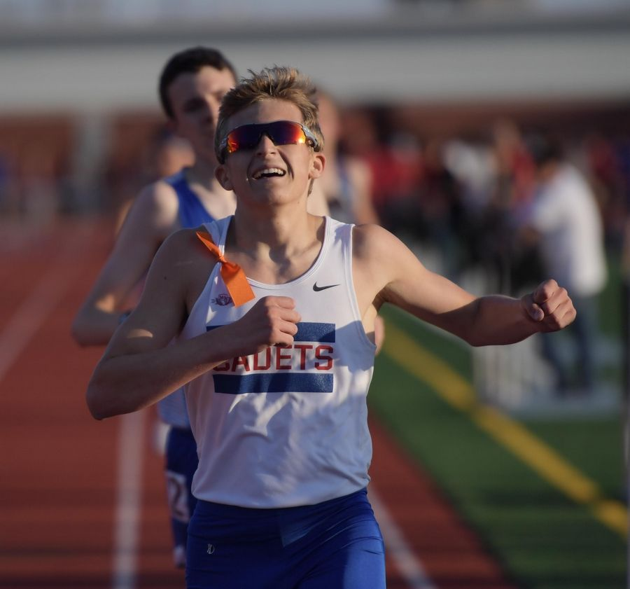 Sean Galle, of Marmion Academy breaths relief as he wins the 3,200 meter run at the Kane County boys track meet at East Aurora High School Friday.