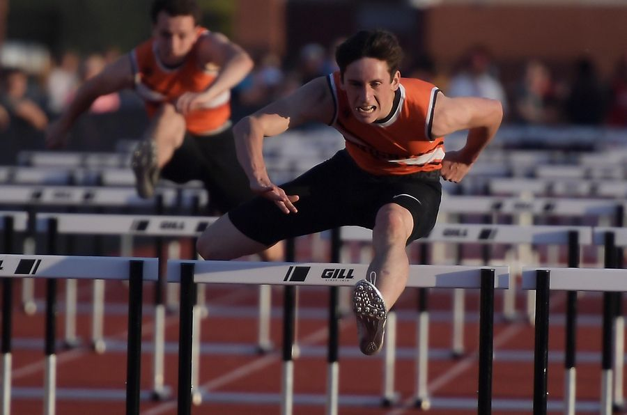 Kaneland's Drew Gould wins his heat of the 100 meter hurdles at the Kane County boys track meet at East Aurora High School Friday.