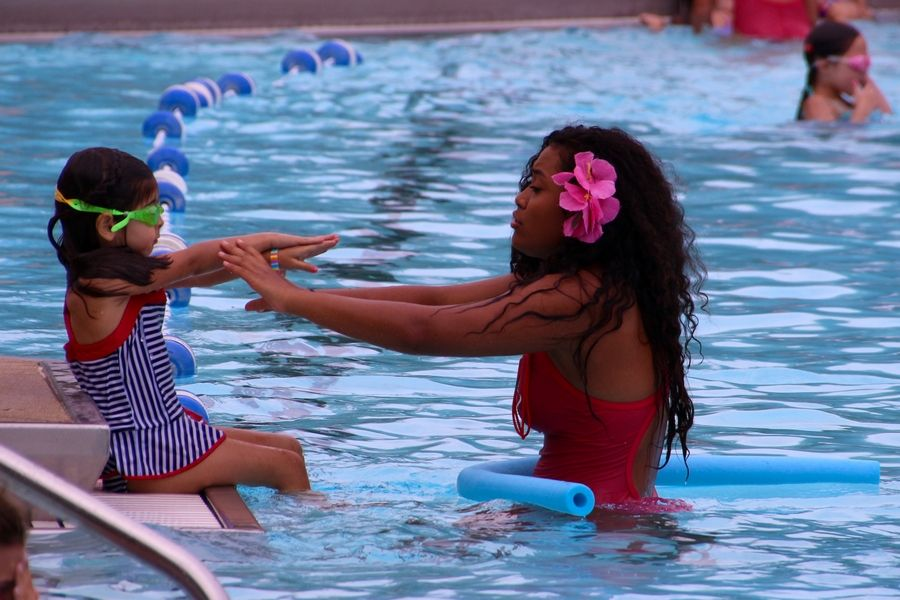 Child prepares to dive into the water at Sunset Pool in Glen Ellyn during a 2017 Learn to Swim class.