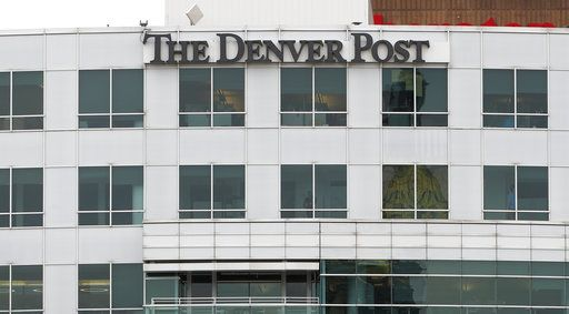FILE - This April 16, 2018, file photo shows the sign for The Denver Post on the side of the newspaper's former headquarters in Denver. Three top figures at The Denver Post, including its former owner, resigned Friday, May 4, 2018, amid budget and staff cuts made by the newspaper's New York-based hedge fund owners. Several Post reporters tweeted that Dean Singleton had stepped down as chairman and from his position on the editorial board. Senior editors Dana Coffield and Larry Ryckman also resigned Friday.