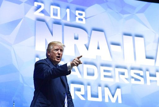 President Donald Trump speaks at the National Rifle Association annual convention in Dallas, Friday, May 4, 2018.