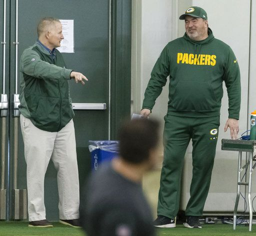 Green Bay Packers head coach Mike McCarty, right, and Russ Ball, executive vice president/director of football operations, talk during NFL rookie football camp in Green Bay, Wis., Friday, May 4, 2018.