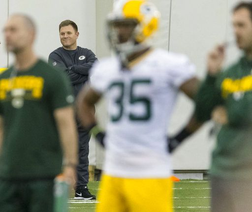 Green Bay Packers general managers Brian Gutekunst smiles as he watches during NFL rookie football camp in Green Bay, Wis., Friday, May 4, 2018.