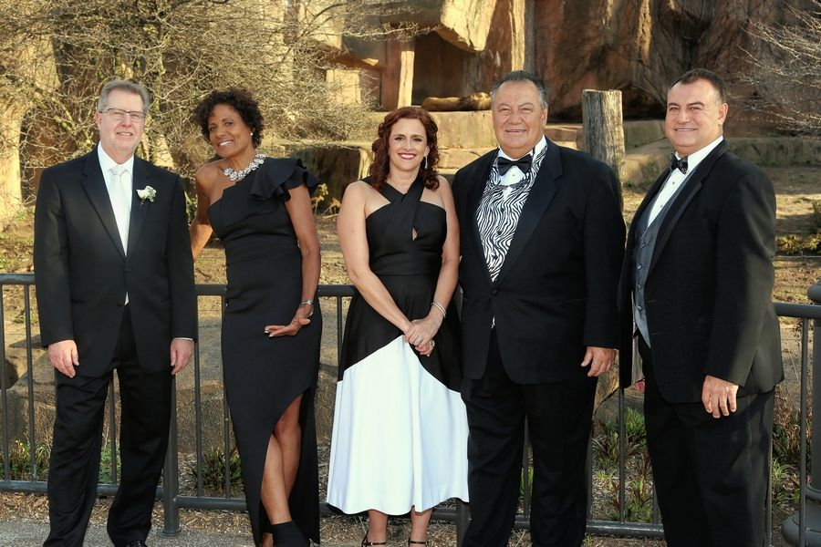 Mark Frey, president & CEO of Amita Health and Alexian Brothers Health System; Robin Robinson, the Alexian Brothers Ball mistress of ceremonies; Melanie Furlan, vice president of advancement for the Alexian Brothers Foundation, and George and Jim Wienold, owners of Bear Construction, gather for the Alexian Brothers Ball de Fleur.