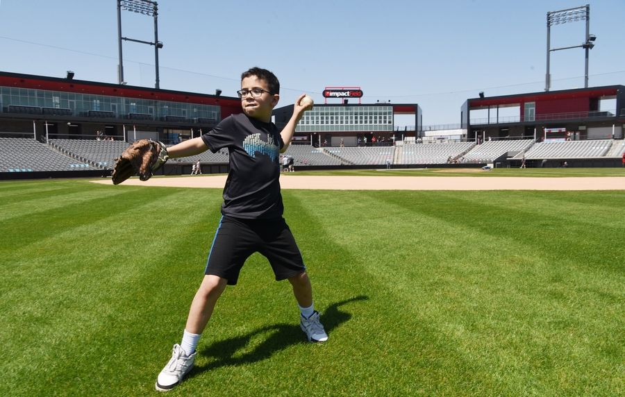Nolan Silk, 10, of Schaumburg plays catch on the field during an open house at Impact Field in Rosemont Saturday.