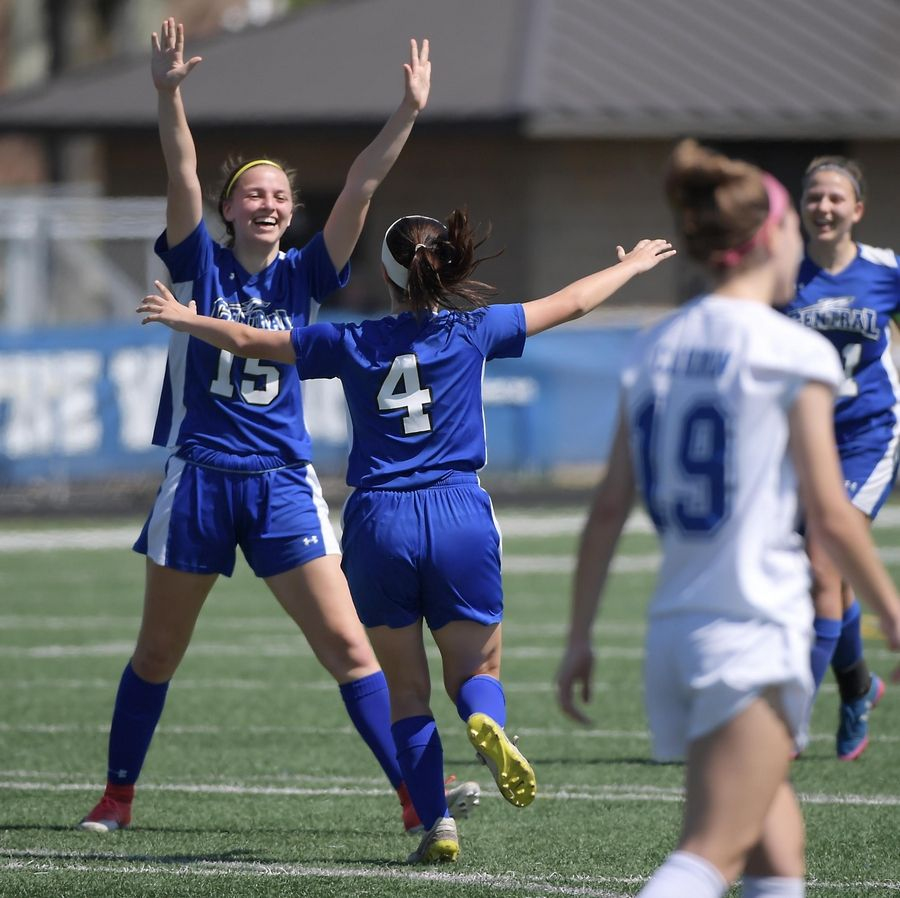 Burlington Central's Zoey Kollhoff celebrates her second goal of the first half with teammate Reagan Oller.