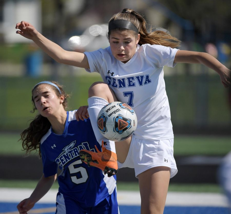 Geneva's Stephanie Howe controls the ball in front of Burlington Central's Kyra Petsche in a girls soccer game Saturday in Geneva.
