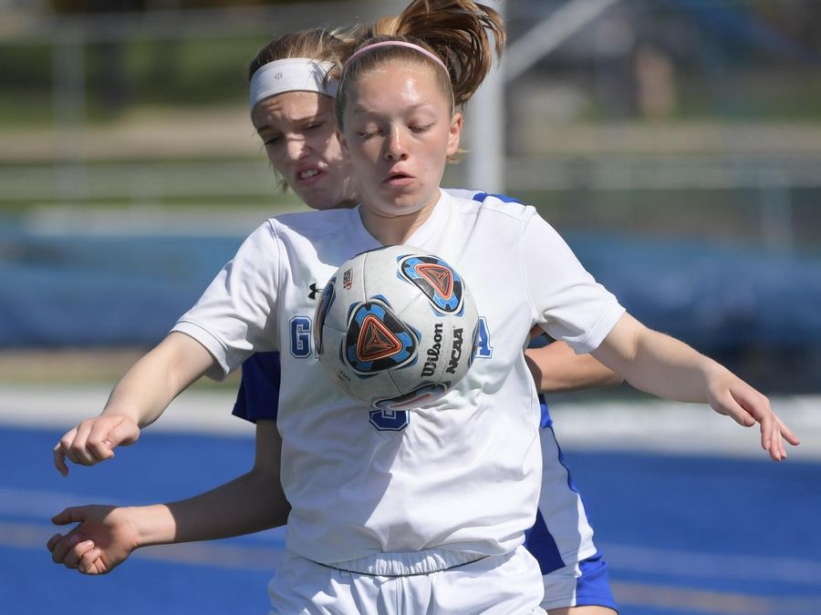 Geneva's Sydney Gratz controls the ball against Burlington Central's Kirsten Wyse in a girls soccer game Saturday in Geneva.