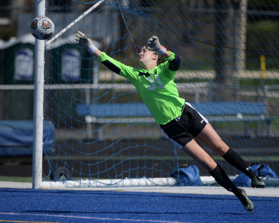 Burlington Central goalkeeper Erin Rafferty stretches but can't reach a shot by Stephanie Howe in a girls soccer game Saturday in Geneva. The shot went wide in the first half.