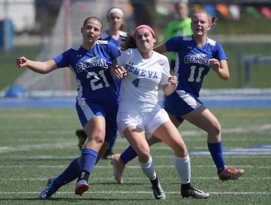 Geneva's Olivia Tegge fights for position for an incoming kick with Burlington Central's Jordan King and Sydney Pryor, right, Saturday in Geneva.