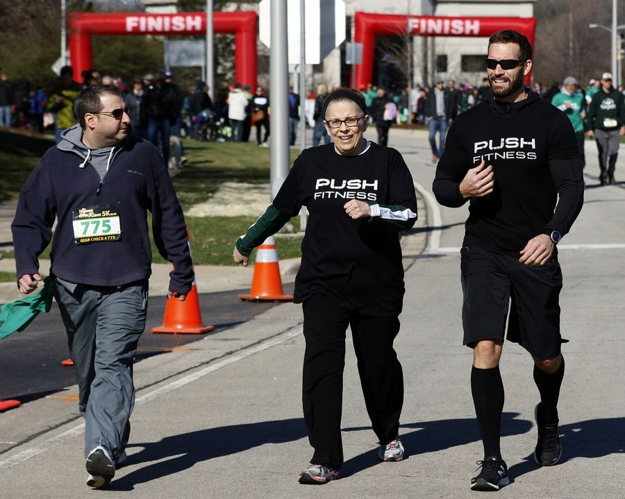 I ran a little, but I mostly walked the course at the DuPage Human Race. Oh, and that's Brian, left, and my trainer, Josh Steckler. My time was 52:57. Not bad for a first try!
