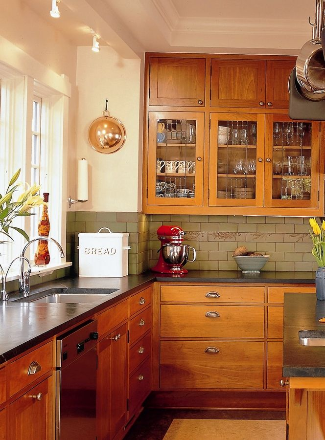 This small kitchen works because the tones are layered, and the colors do not sharply contrast.