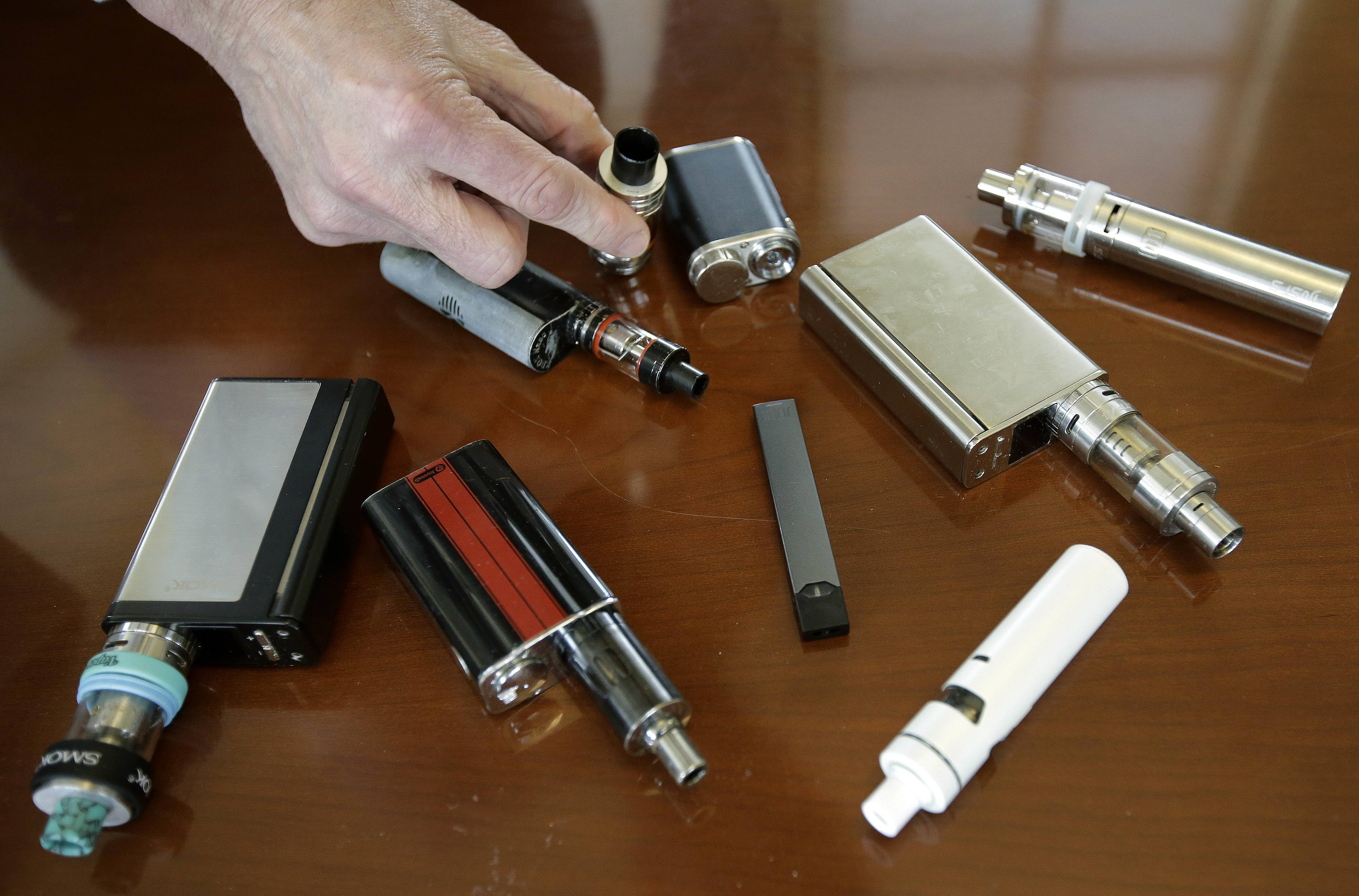 Principal Robert Keuther displays vaping devices that were confiscated from students at Marshfield High School in Massachusetts.