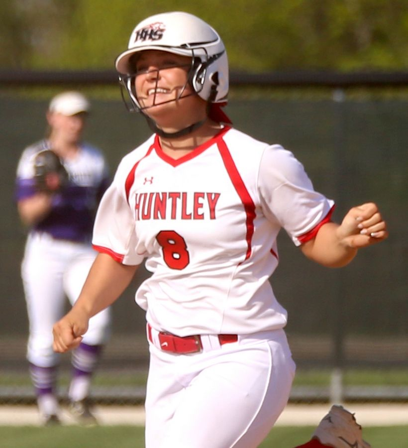 Huntley's Sofia Tenuta is all smiles as she rounds the bases after belting a second-inning home run during varsity softball at Hampshire Monday. Huntley blanked the host Whip-Purs 13-0 in five innings.