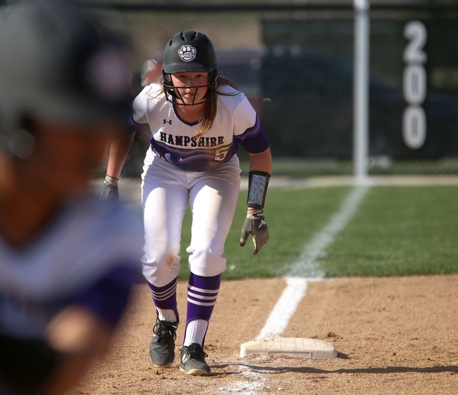 Hampshire's Sarah Bowen takes her lead at third base as teammate Jasmine Lopez bats during varsity softball at Hampshire Monday. Huntley blanked the host Whip-Purs 13-0 in five innings.