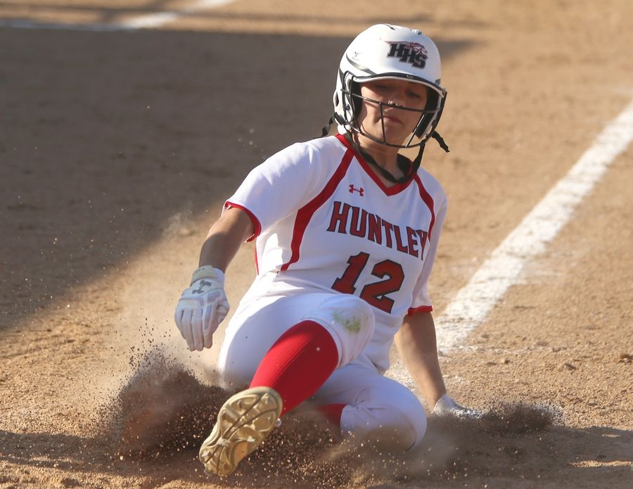 Huntley's Kendra Mitchell slides safely into home in the fifth inning during varsity softball at Hampshire Monday. Huntley blanked the host Whip-Purs 13-0 in five innings.