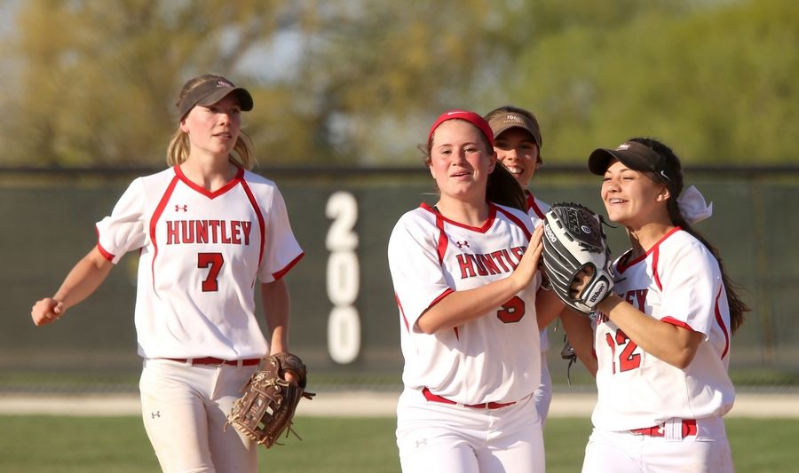 The Red Raiders of Huntley, from left, Autumn Kasal, Paige Berkmeyer, Tiffany Giese and Kendra Mitchell celebrate victory during varsity softball at Hampshire Monday. Huntley blanked the host Whip-Purs 13-0 in five innings.