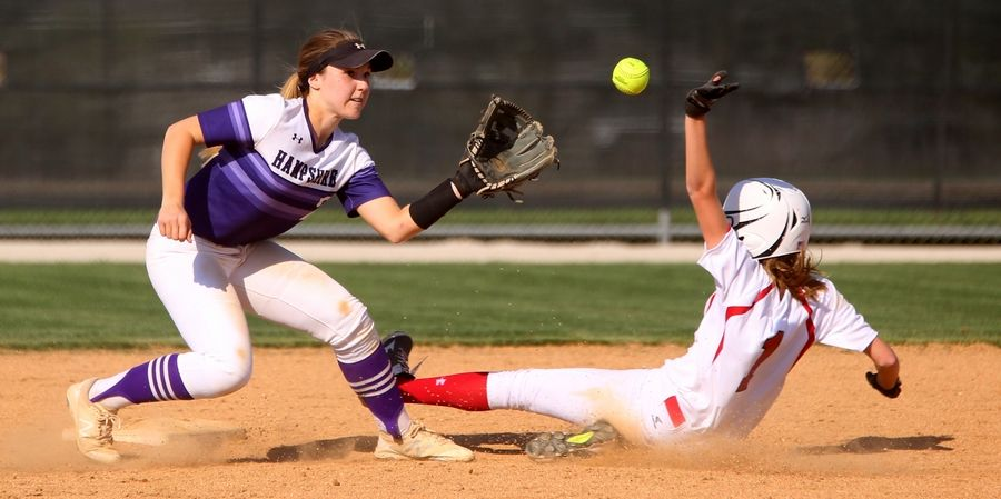 Huntley's Marley Reicher, right, is safe stealing second base as Hampshire's Delaney Rummell, left, fields the throw in the second inning during varsity softball at Hampshire Monday. Huntley blanked the host Whip-Purs 13-0 in five innings.