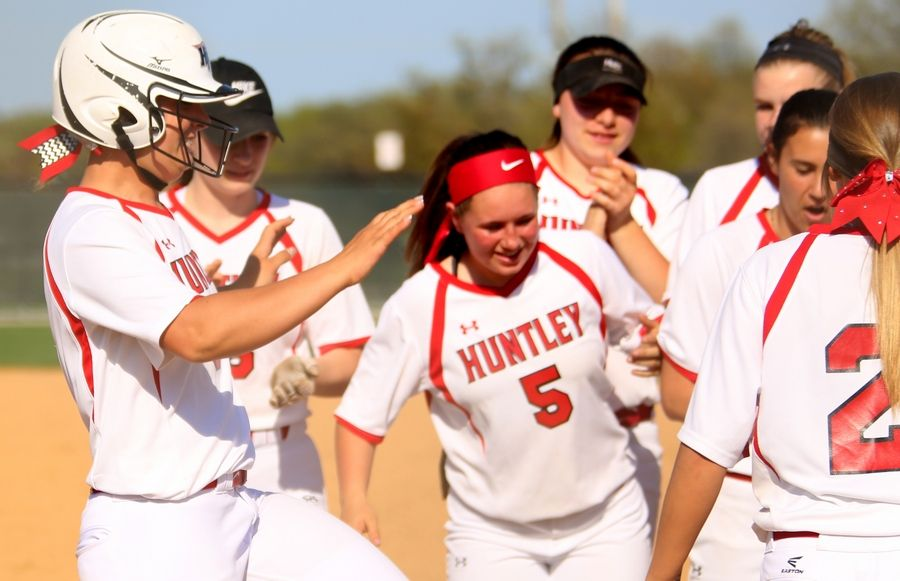 Huntley's Sofia Tenuta, left, lands at home after belting a second-inning home run during varsity softball at Hampshire Monday. Huntley blanked the host Whip-Purs 13-0 in five innings.