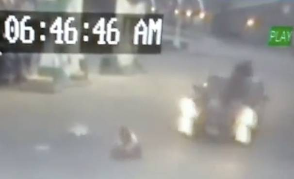 This frame shows the girl's father and driver of the car jumping on the hood of the car driven by the carjacker's accomplice.