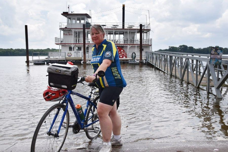 "Tracy Sefcik of Wheeling dipped her bike's tires in the Atlantic Ocean last week to complete her cross-country bike ride to raise money for fellow veterans. Despite numerous challenges along the way, she said the one word that best describes the journey is ""amazing."""