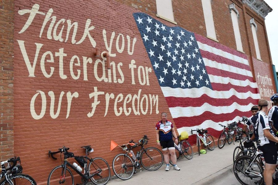 Tracy Sefcik of Wheeling stops at a mural during her cross-country bike journey that ended last week in Florida. Sefcik pedaled from the Pacific to the Atlantic Ocean to raise money for the Gary Sinise Foundation.
