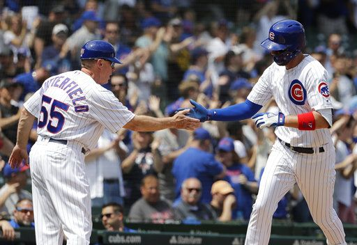 Chicago Cubs' Kris Bryant, right, celebrates with third base coach Brian Butterfield after hitting a solo home run during the first inning of a baseball game against the Miami Marlins, Wednesday, May 9, 2018, in Chicago.
