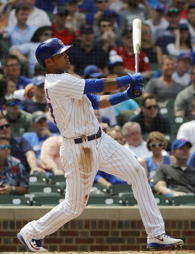 Chicago Cubs' Addison Russell hits a two-run home run against the Miami Marlins during the third inning of a baseball game Wednesday, May 9, 2018, in Chicago.