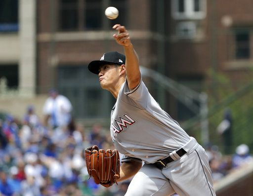 Miami Marlins starting pitcher Wei-Yin Chen, of Taiwan, throws against the Chicago Cubs during the first inning of a baseball game Wednesday, May 9, 2018, in Chicago.