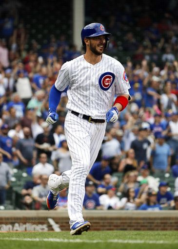 Chicago Cubs' Kris Bryant smiles as he runs to bases after hitting an RBI double against the Miami Marlins in the third inning of a baseball game Wednesday, May 9, 2018, in Chicago.