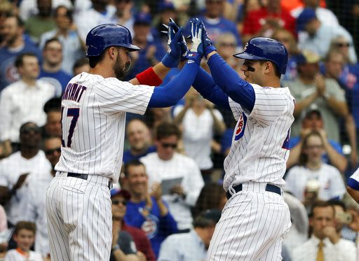 Chicago Cubs' Anthony Rizzo, right, celebrates with Kris Bryant after hitting a three-run home run against the Miami Marlins in the third inning of a baseball game Wednesday, May 9, 2018, in Chicago.