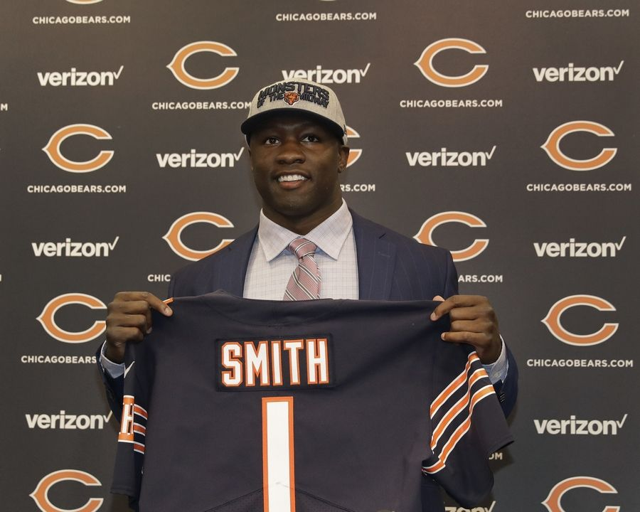 Chicago Bears first round draft pick, University of Georgia linebacker Roquan Smith, poses with a jersey during an introductory NFL football news conference Friday, April 27, 2018, in Lake Forest , Ill.
